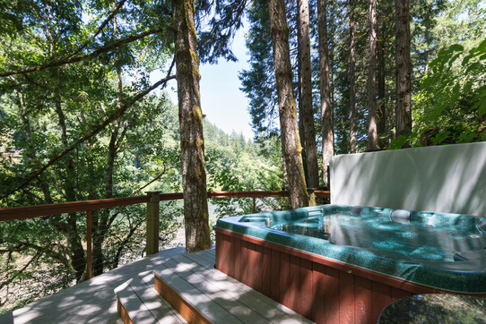 Image 6 person hot tub overlooking the river